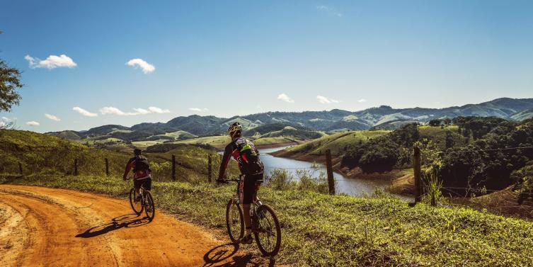cyclists-trail-bike-clouds-163407